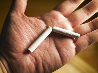 breaking  cigarette on hand