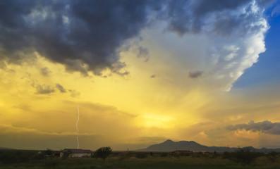 A Lightning Strike in a Sunset Sky
