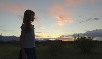 A Girl in Profile as the Sun Sets