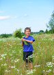 Boy with wild spring flowers