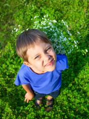 Boy with wild spring flowers