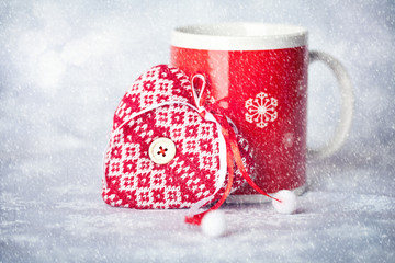 Christmas card. Christmas mug on a snowy background .