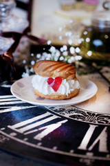 cake profiteroles with cream and marmalade heart