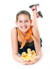 Girl with cute ducklings