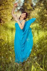 Girl in a beautiful blue fluttering dress.