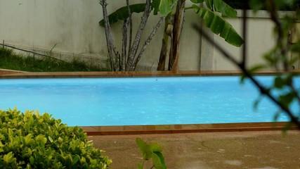 Swimming Pool in Bad Weather under Rain.