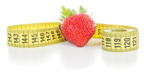 Strawberries with measuring tape