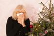 Senior woman is crying with Christmas holidays