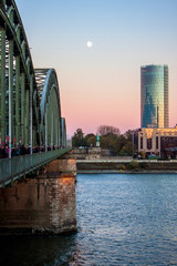 Evening view of Hohenzollern Bridge and the Moon in Cologne