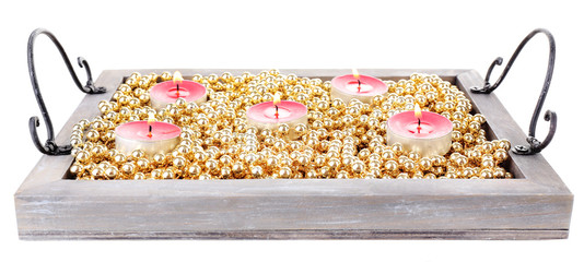 Candles on vintage tray with decorative beads, isolated on