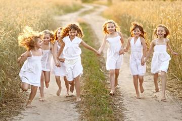 portrait of little girls running on the field