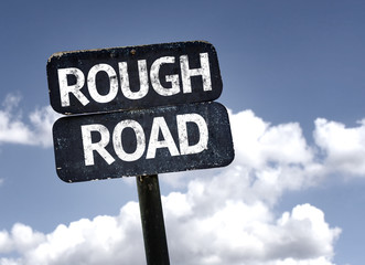 Rough Road sign with clouds and sky background