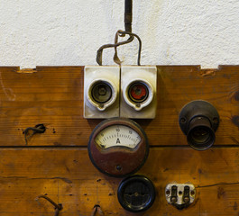 Measuring device socket and fuse on wooden panel