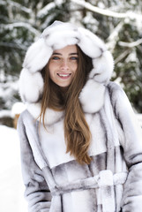 close-up portrait of beautiful smiling girl in winter