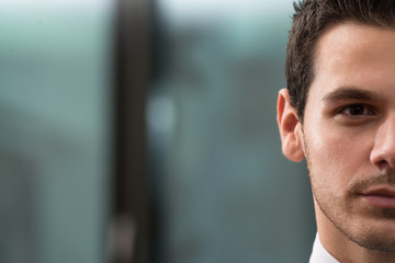 Portrait Half Of Face Of Young Businessman