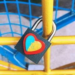 Heart in the colors of Ukrainian flag drawn on the lock