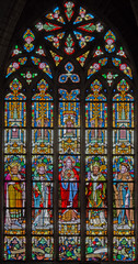 Mechelen - heart of Jesus and saints on windowpane
