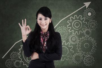 Businesswoman making an ok sign 2