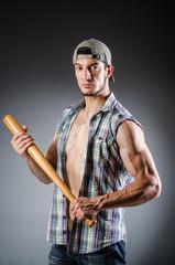 Violent man with baseball bat and hat