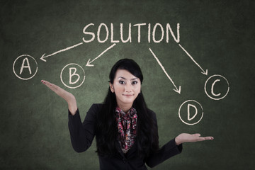 Confused businesswoman to choose solution