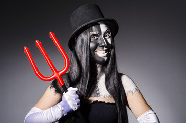Satana woman with pitchfork and facemask