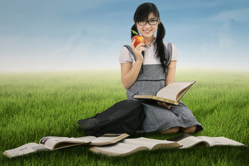 Female student studying outdoors