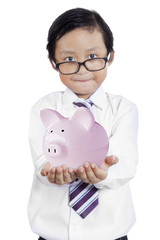 Little businessman showing piggybank