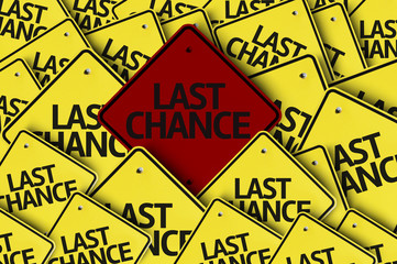 Last Chance written on multiple road sign