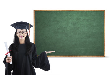 Young graduate showing empty board