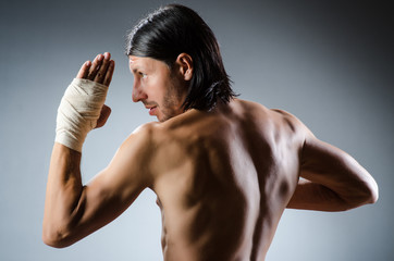 Ripped martial arts expert at training