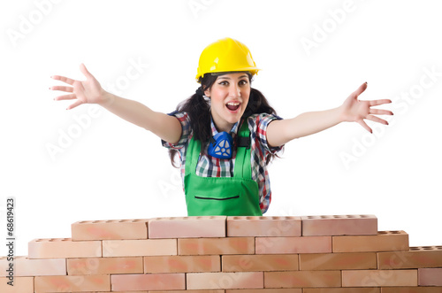 Woman builder isolated on the white