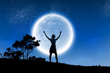 Woman and full moon
