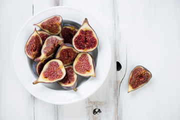 Sliced fig fruits in a glass plate, above view, horizontal shot