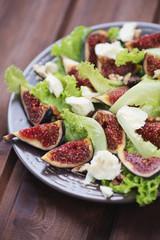 Fig fruits, cheese and walnuts salad, close-up, vertical shot