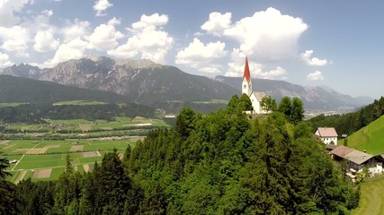 St. Peter Church in the Austrian Alps - Aerial Flight