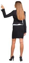 Businesswoman pointing her finger upward