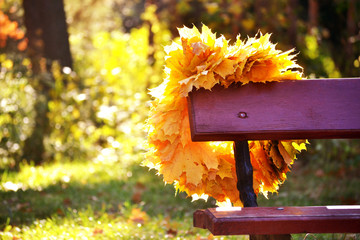 bench and wreath of yellow leaves