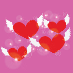 red heart with white angel wing on pink background