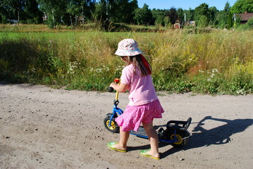 Kind mit Roller