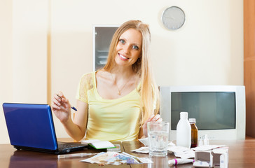 Positive woman reading about medications on the Internet