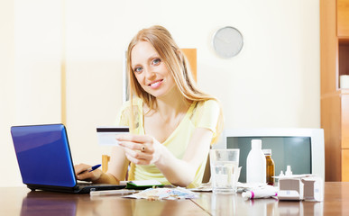 Youbg woman shopping medications on internet from home