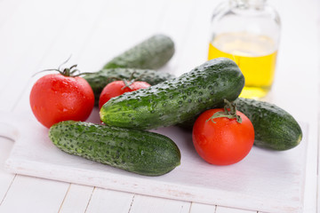 Fresh cucumbers on wooden background