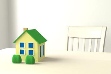 テーブル上の家のモデルと椅子