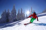 Fototapeta Skier against blue sky in high mountains
