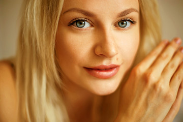 Emotive portrait of young beautiful woman with long blonde hair.