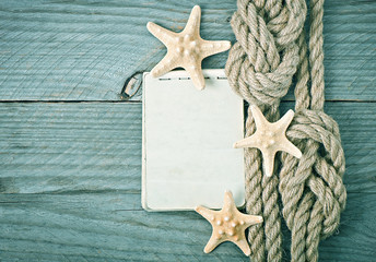 Paper and rope on wooden background