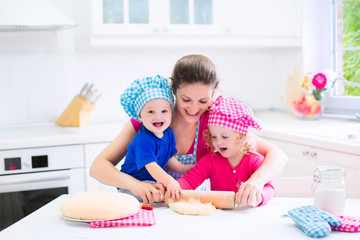 Mother and kids baking a pie