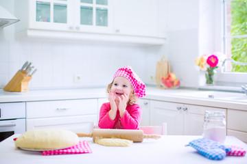 Cute little girl baking a pie