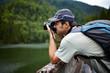 Tourist taking photos of a lake