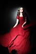 Elegant woman in long dress Red fashion model